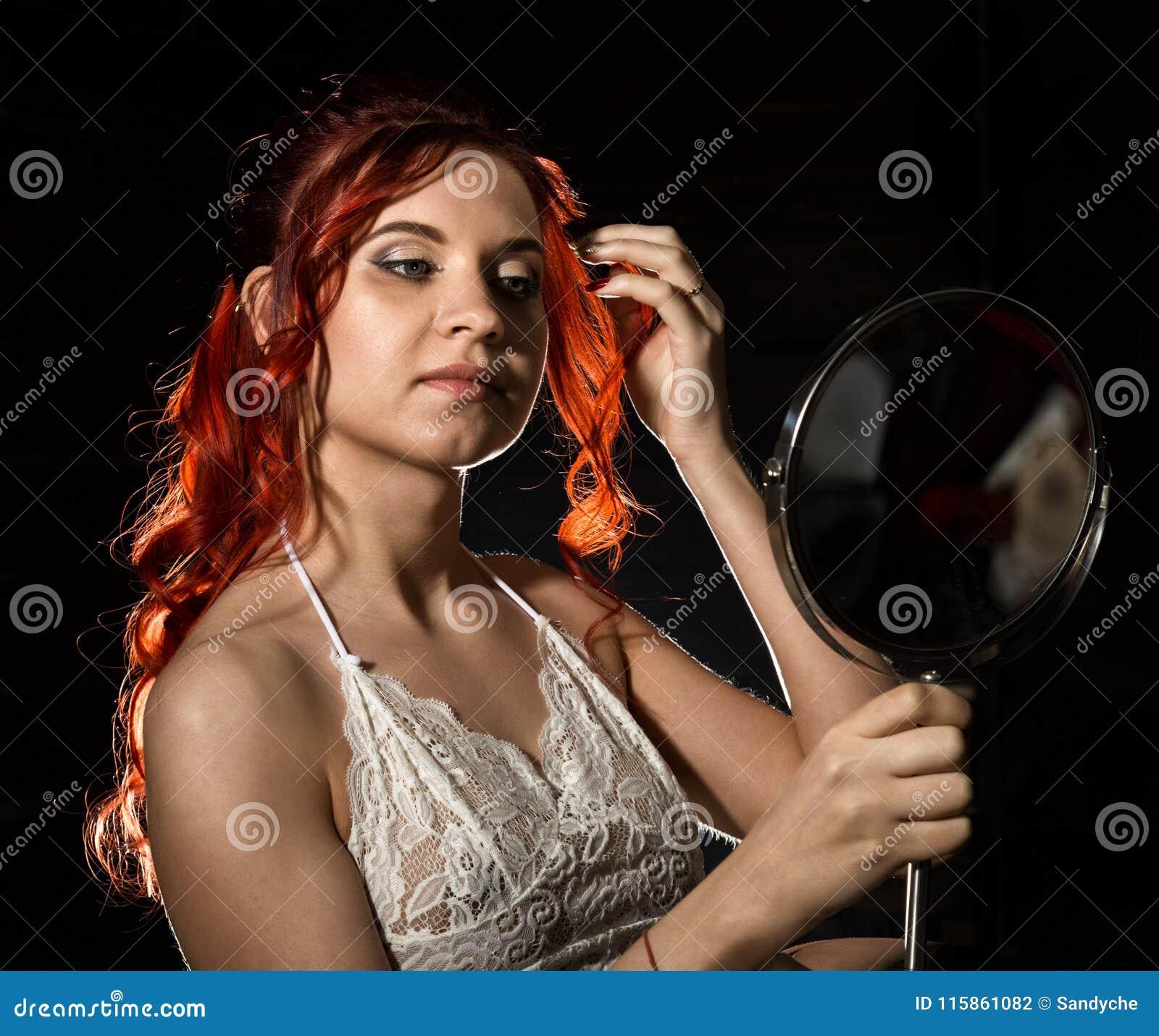 Redhead eating a brunnette