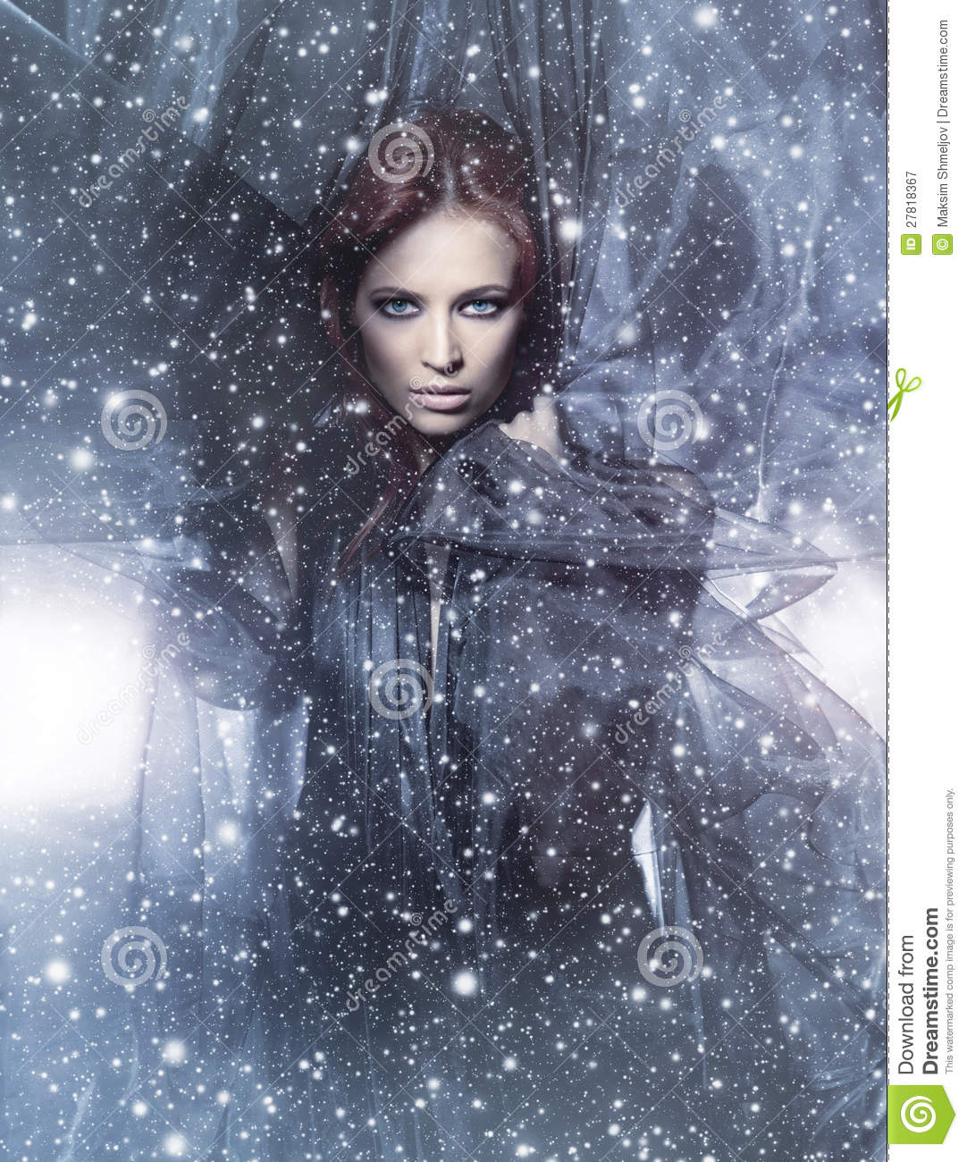 A young redhead woman on a snowy background