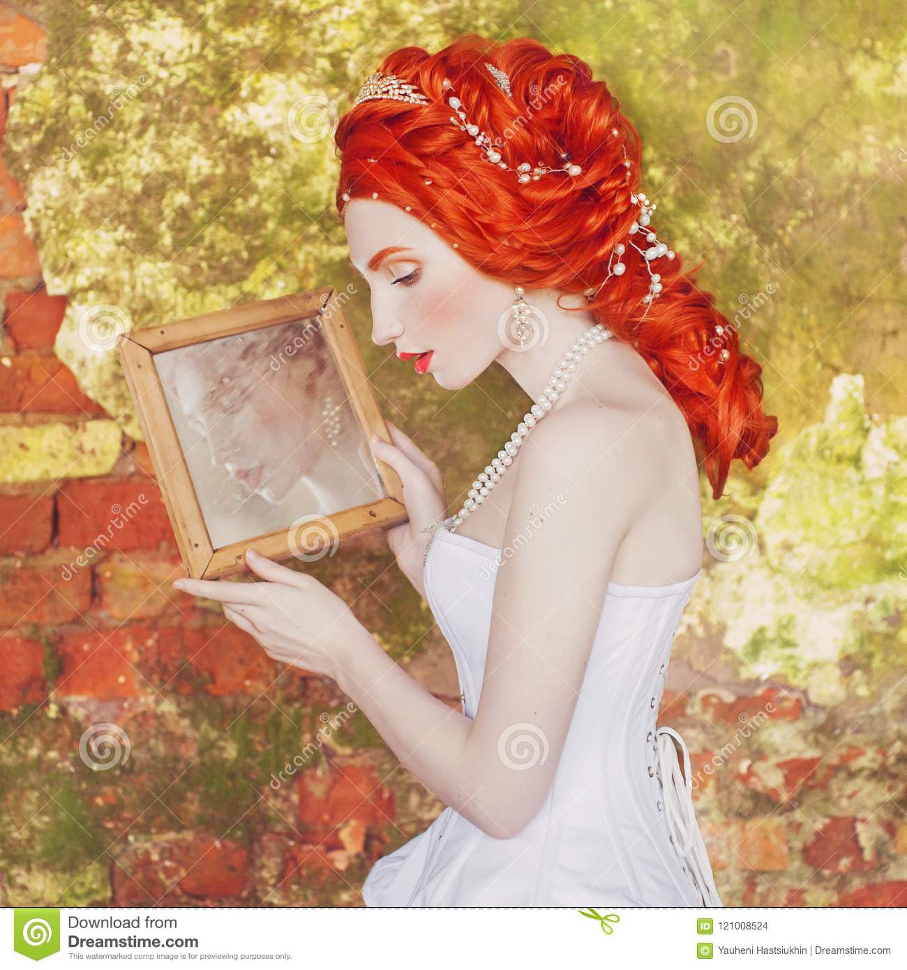 971a1218d8e Young renaissance redhead princess with hairstyle in the old castle. Fabulous  rococo queen in white dress against the backdrop of old stone wall. Doll in  ...