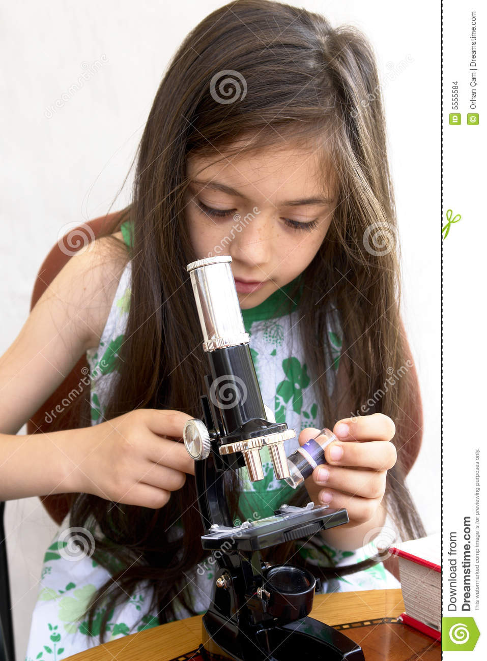 Young researcher analyses with a microscope