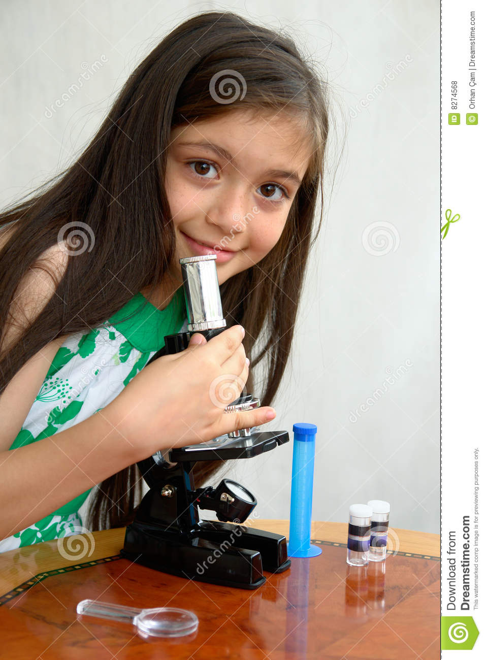 Young researcher analyzes with a microscope