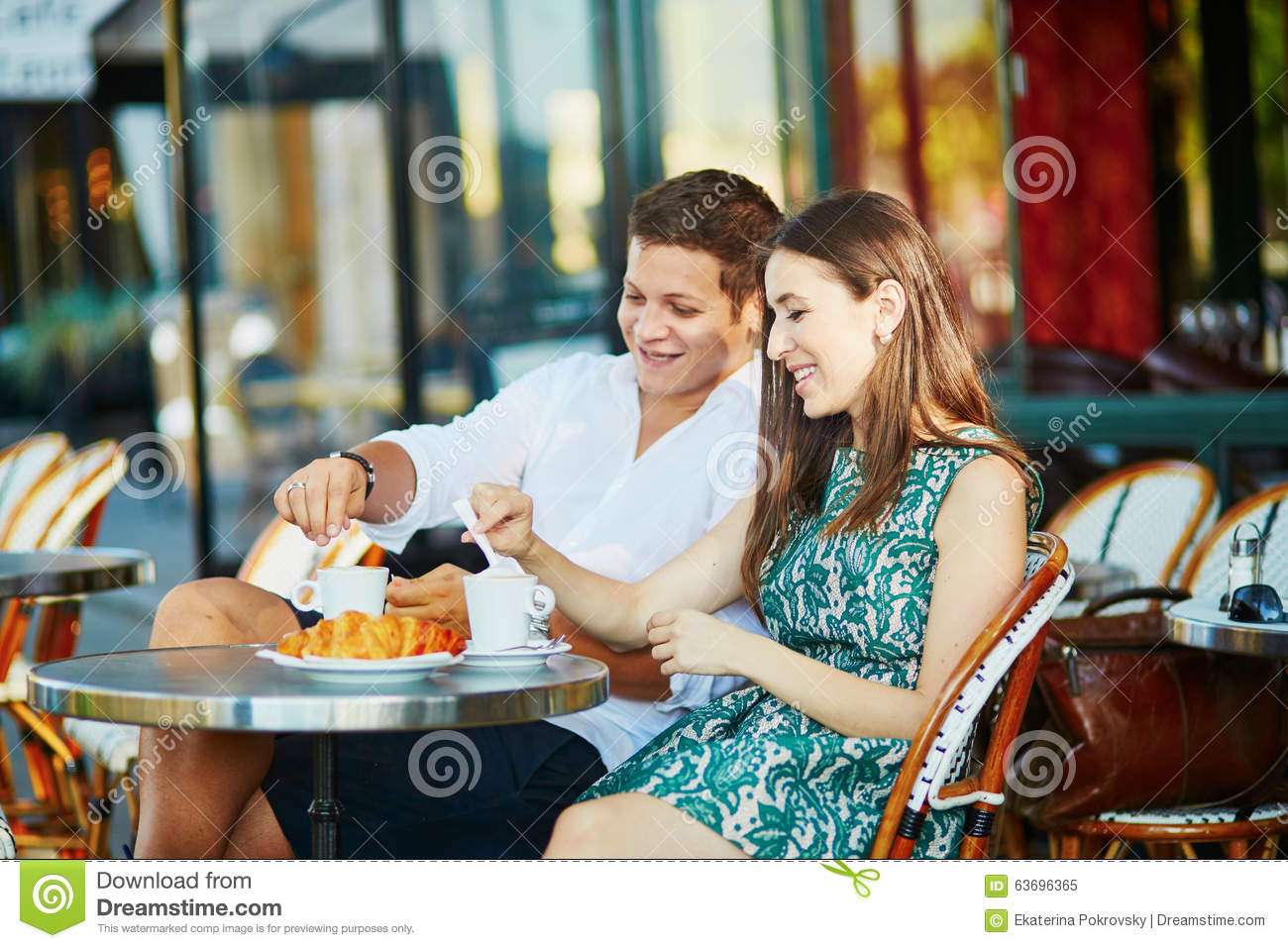 Young Romantic Couple In A Cozy Outdoor Cafe In Paris ...