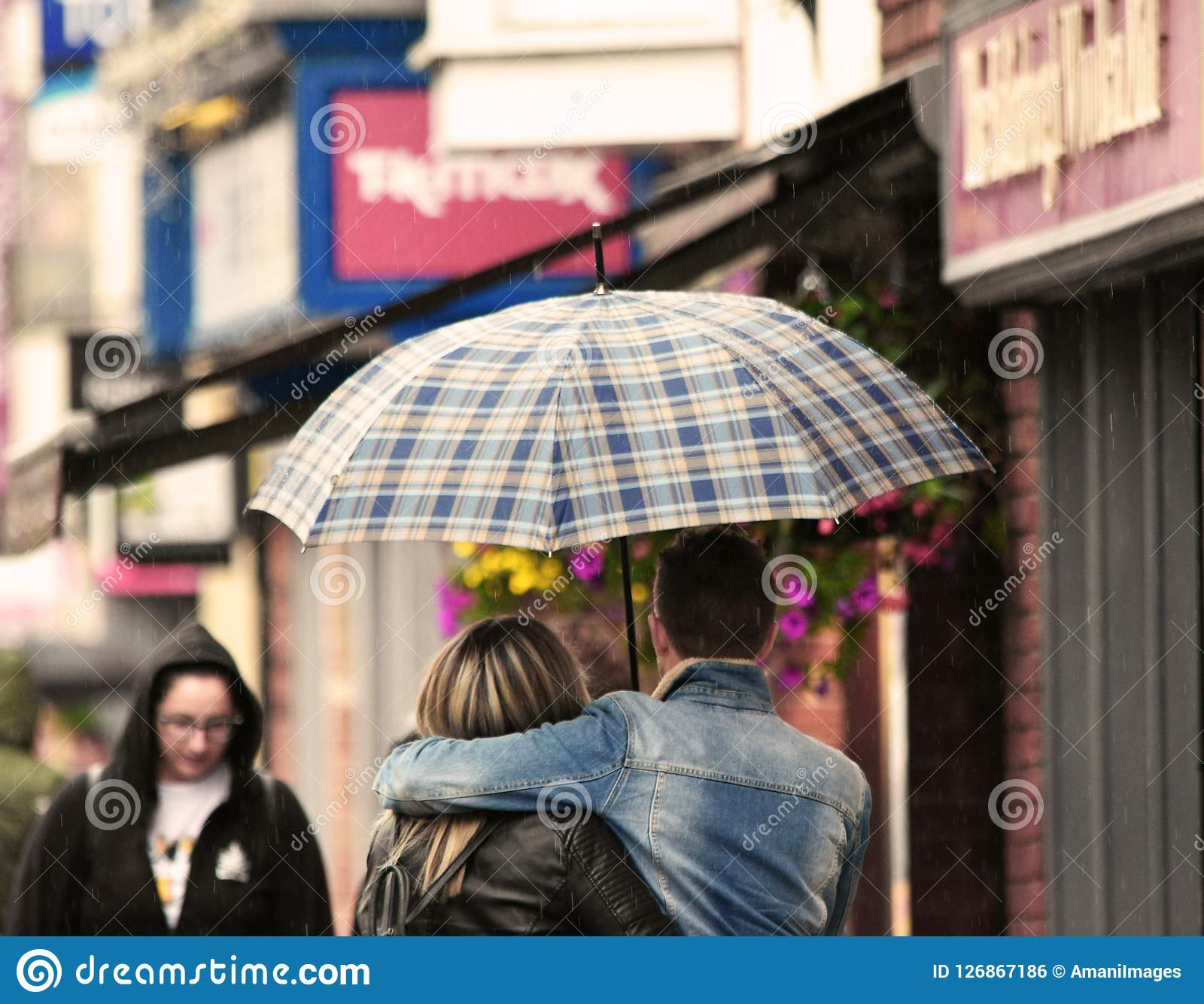 Young romantic couple in the rain