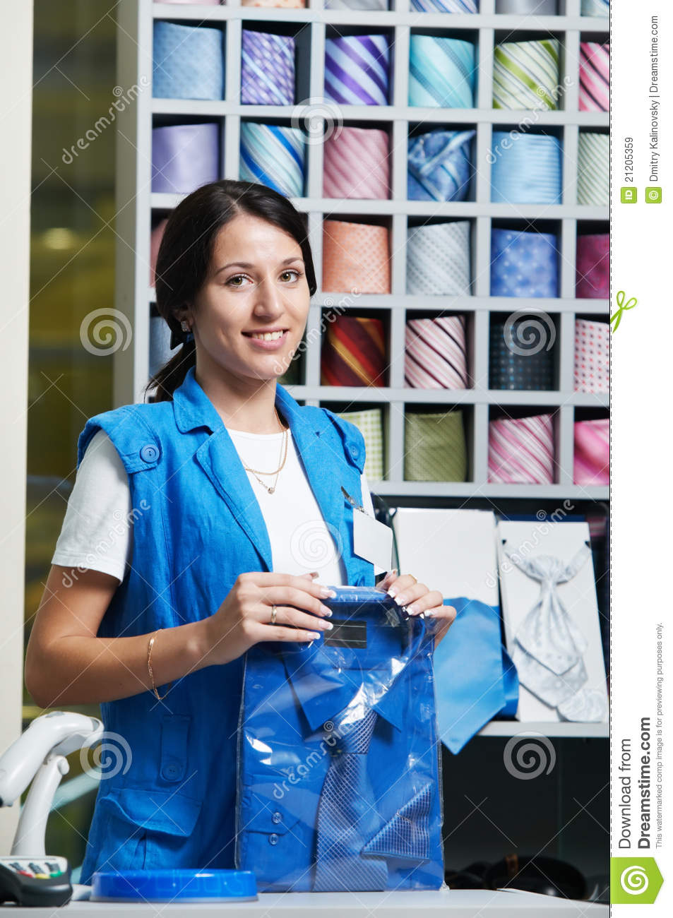 young salesperson girl at clothes shop stock image