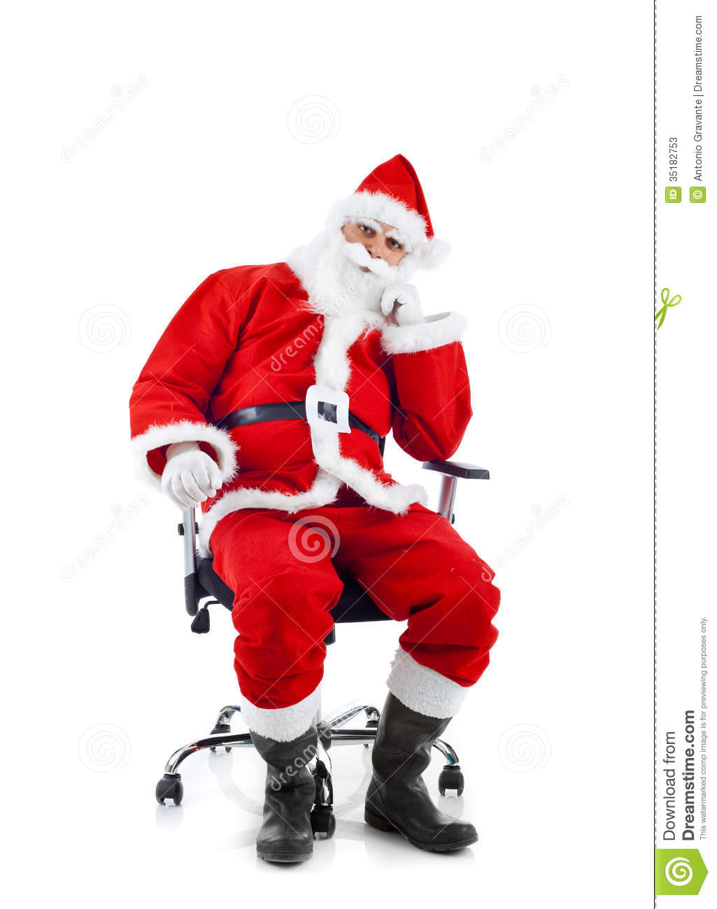 Young Santa Claus Sitting On An Office Chair Stock Image