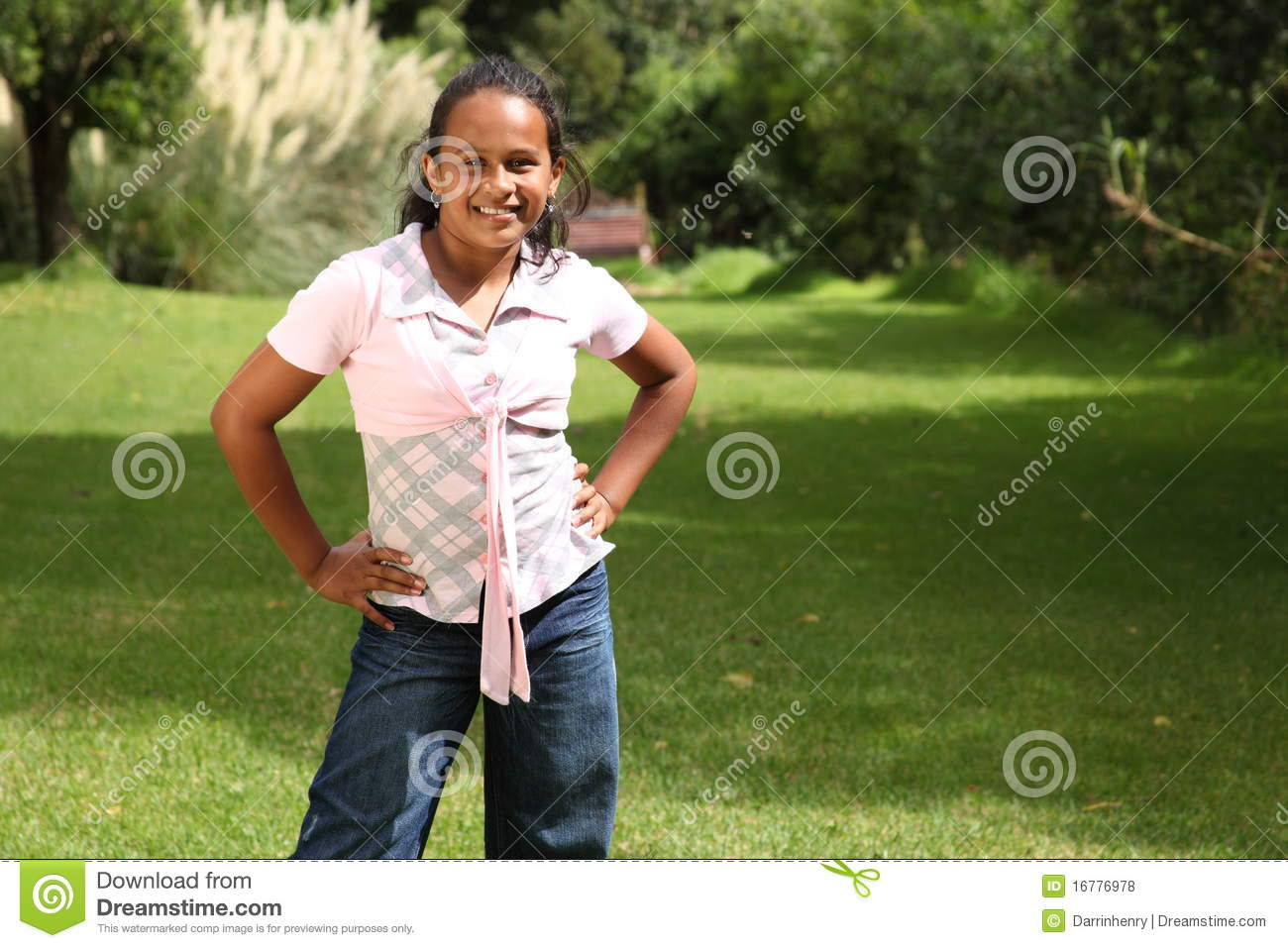 ... Free Stock Photos: Young school girl standing in park hands on hips