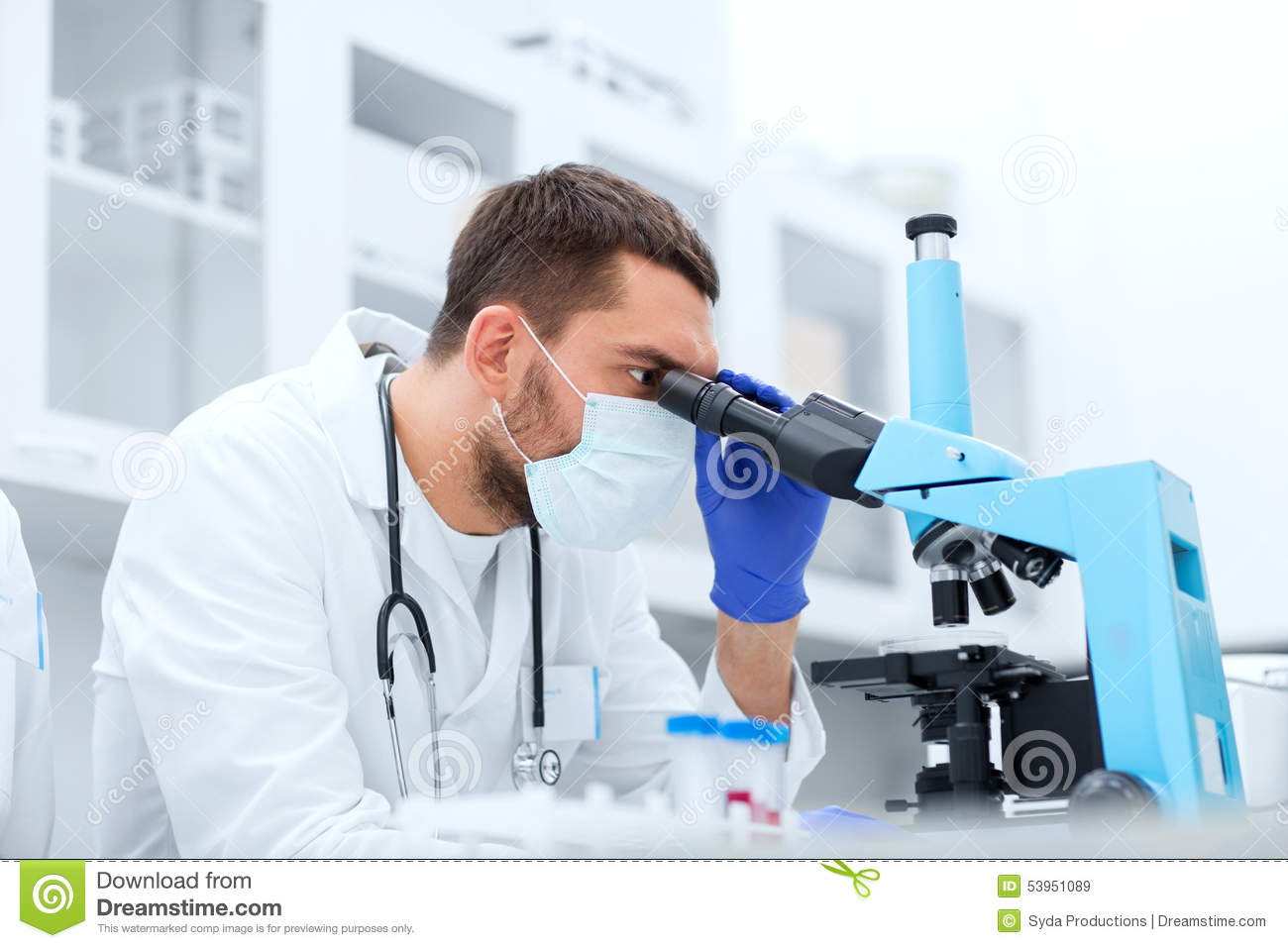 Young Scientist Looking To Microscope In Lab Stock Photo - Image ...