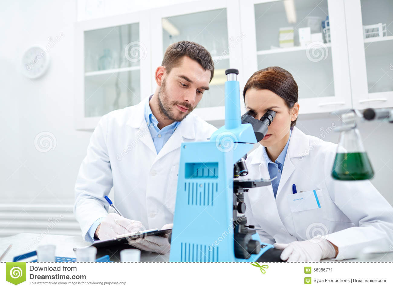 young scientists making test or research in lab stock