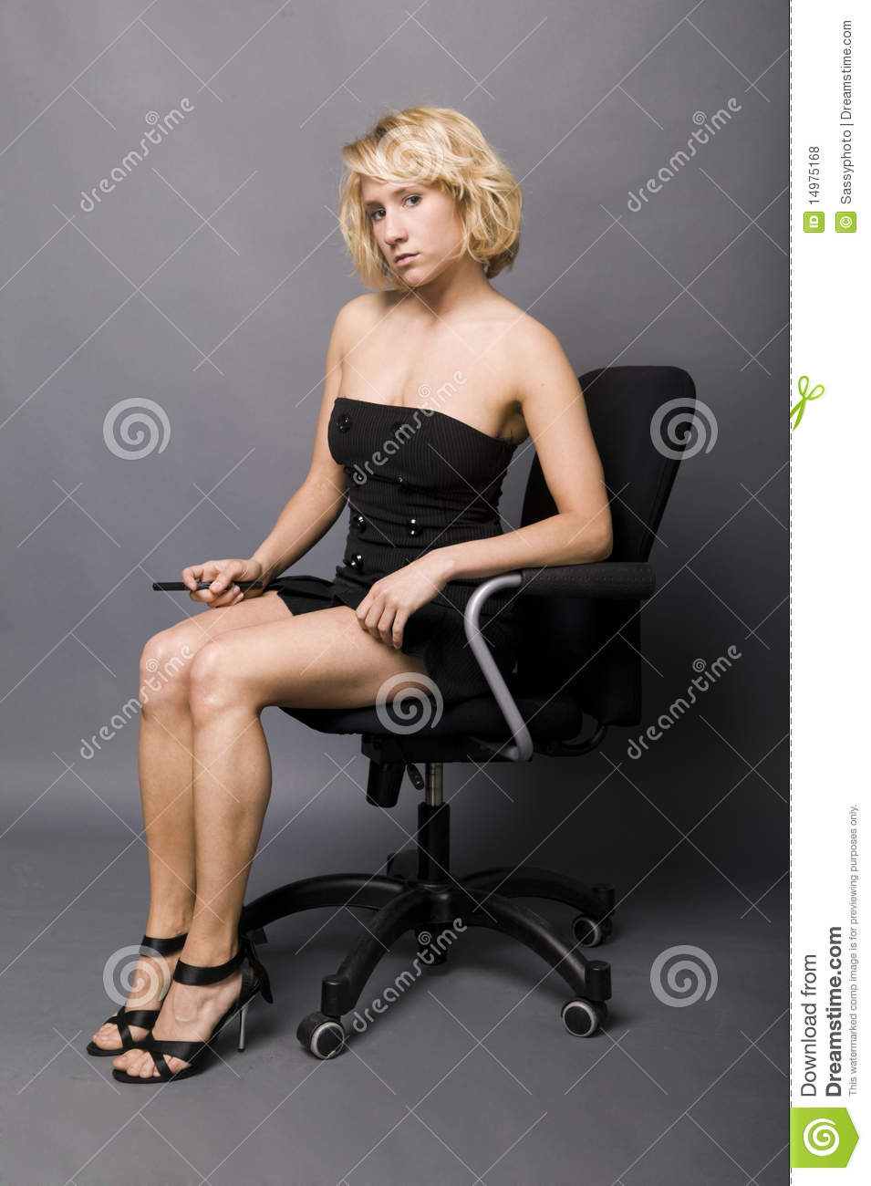 Young Secretary Sitting On An Office Chair Royalty Free