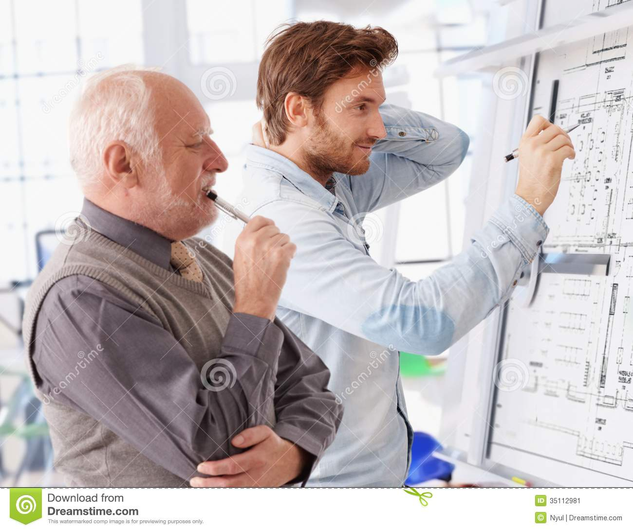 Young and senior architects working together stock image for An architect