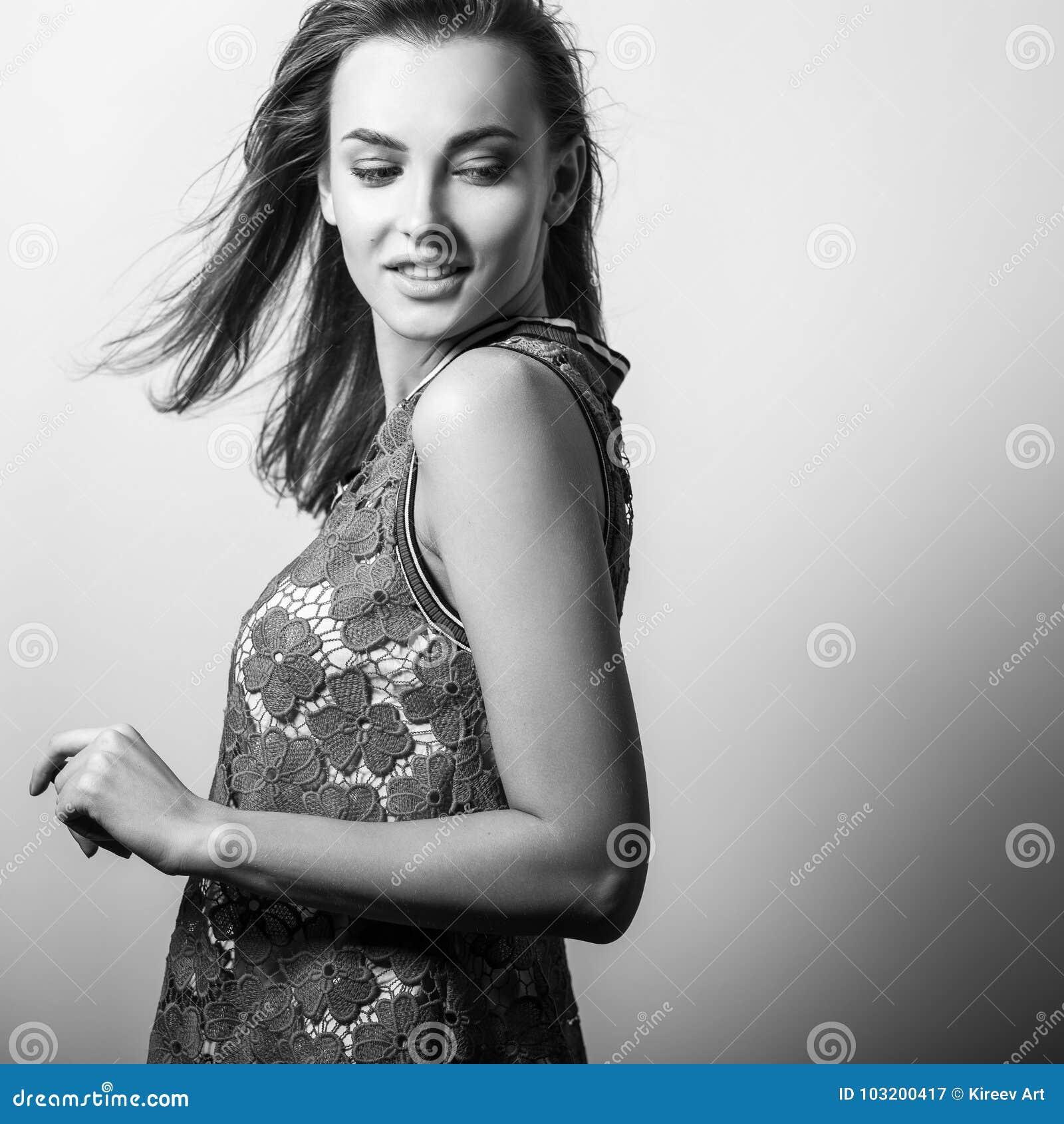 Young sensual model woman pose in studio black white photo
