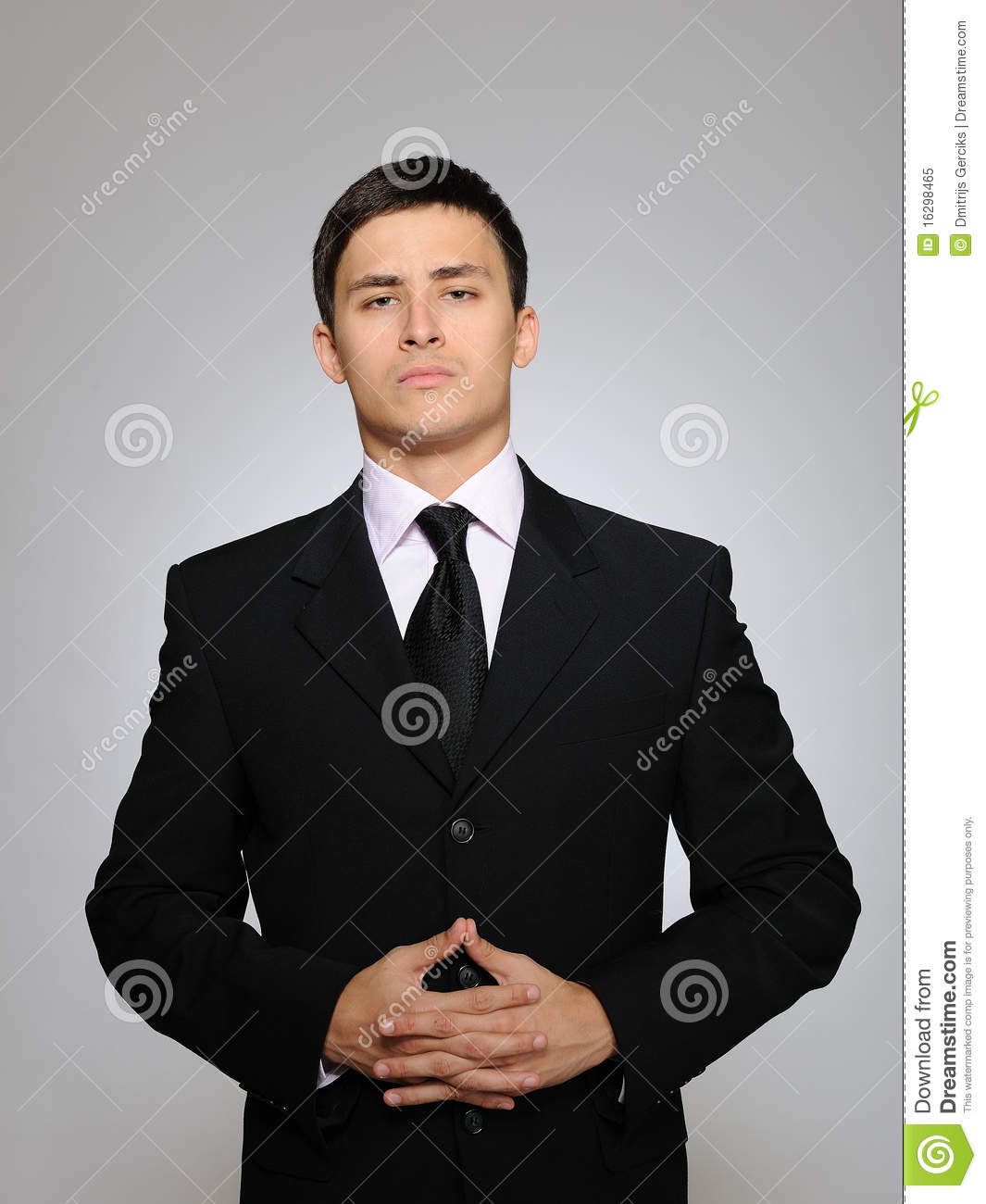 young-serious-business-man-black-suit-tie-16298465.jpg