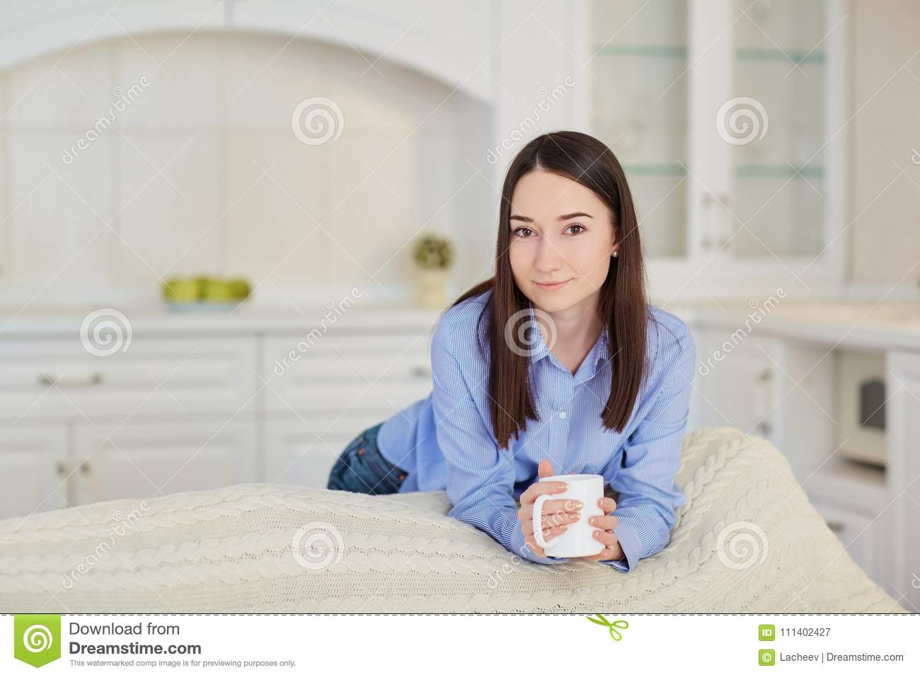 Young Serious Girl With A Cup Of Hot Drink In The Kitchen Stock ...