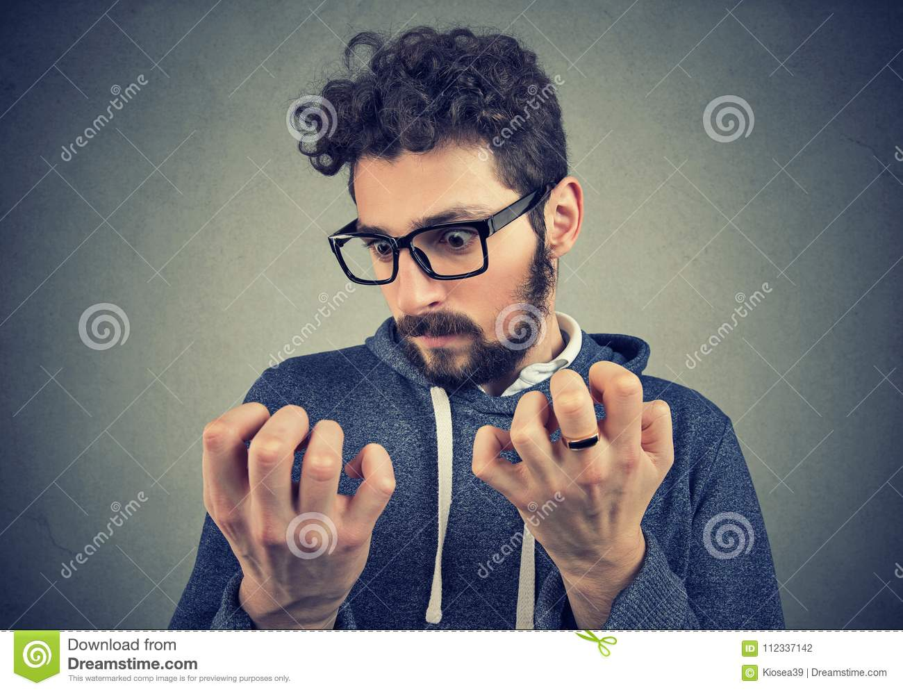 Man with obsessive compulsive disorder exploring cleanliness of hands.