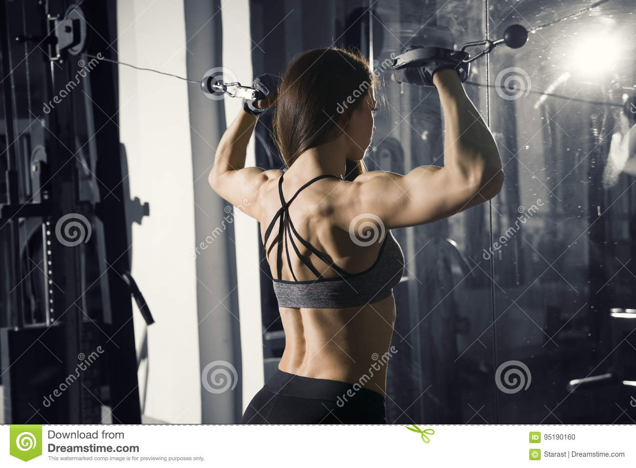 4d5ca23339e11 Young fitness woman workout with training machine in the gym, perfect  muscular body