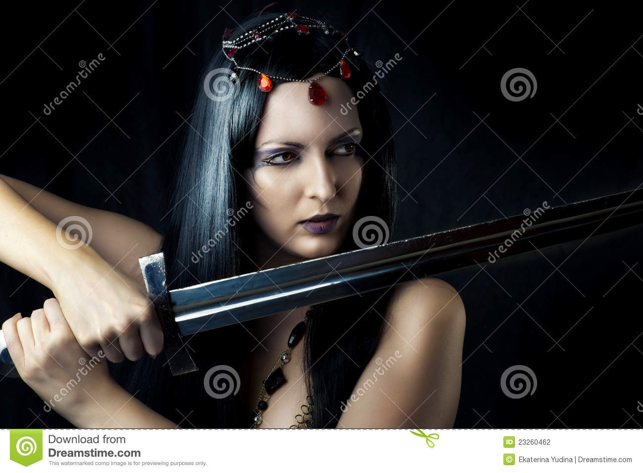 Young girl warrior holding sword