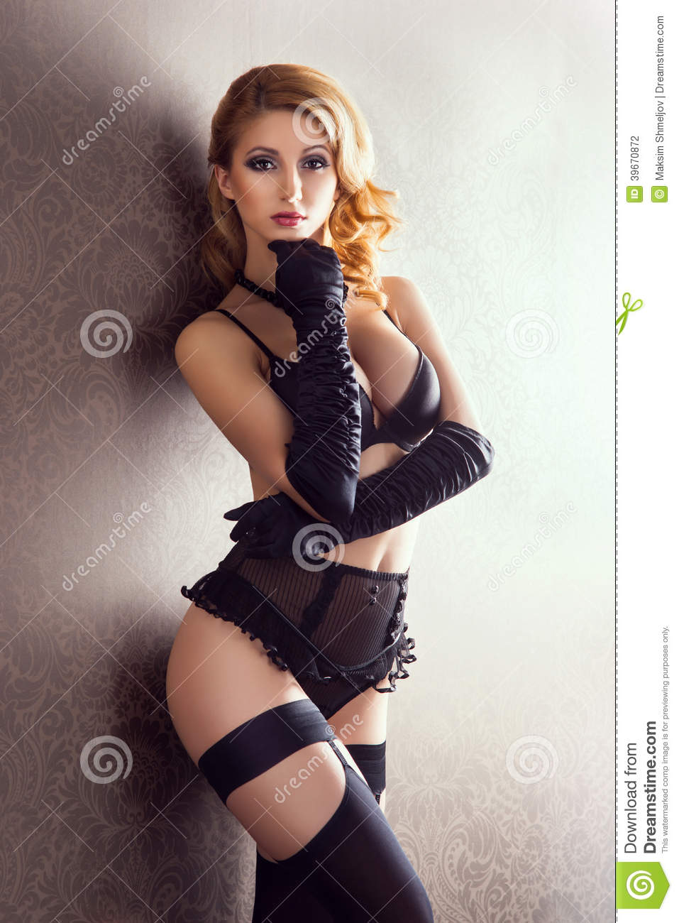 aaf1b8577 A Young And Woman Posing In Erotic Lingerie Stock Photo - Image of ...