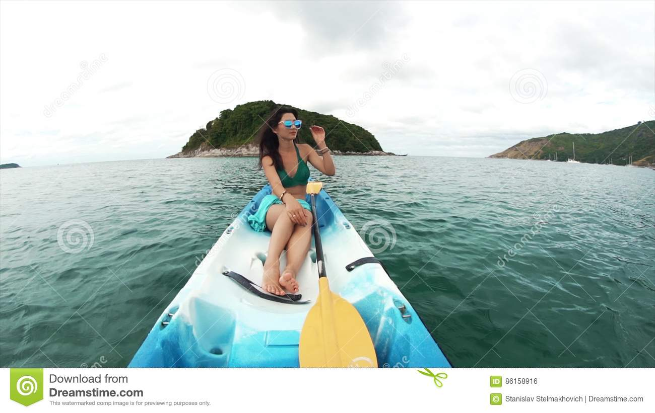 08489b135f Young Woman In Sunglasses In A Boat Stock Footage - Video of canoe ...