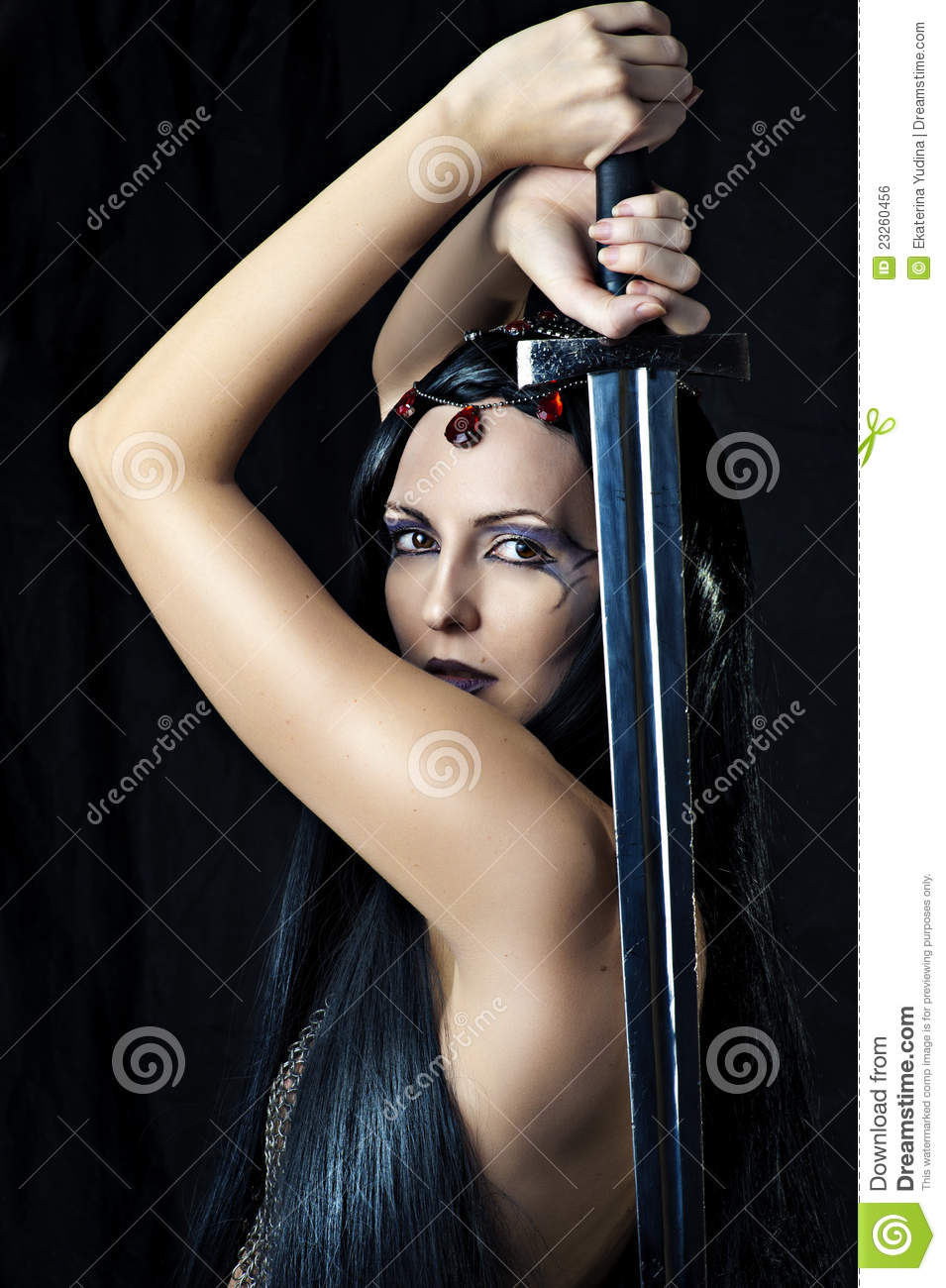 Young woman warrior holding sword