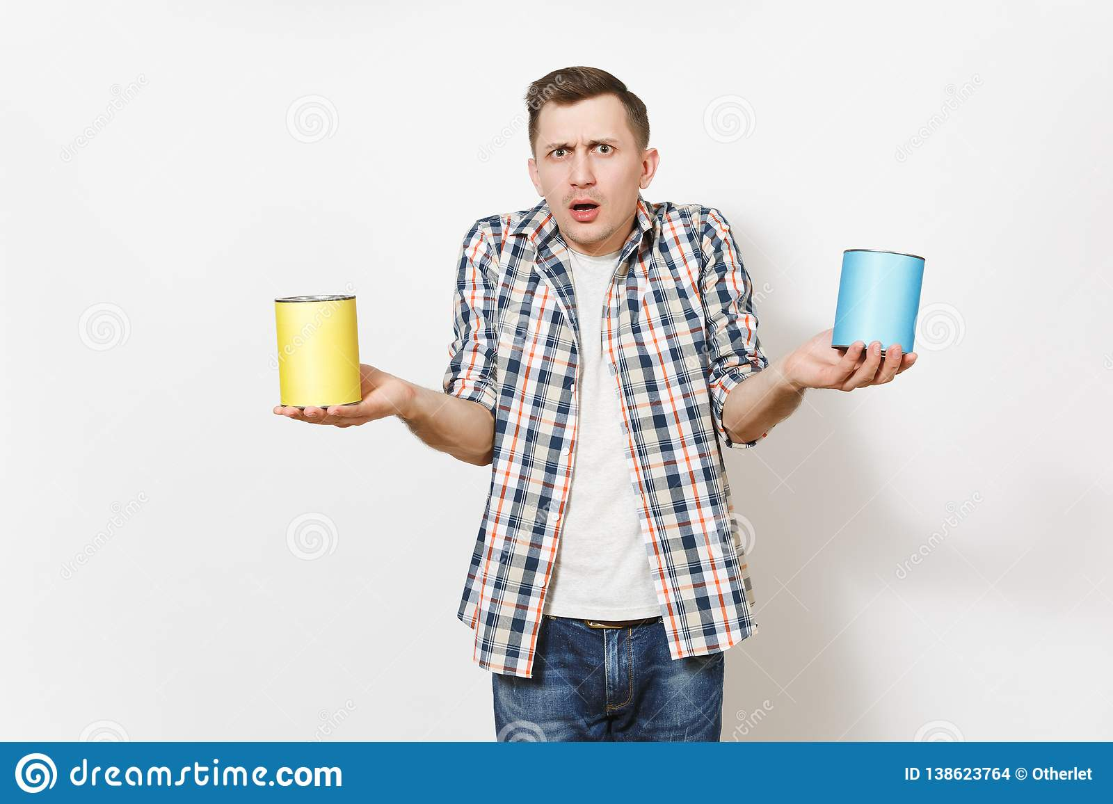 Young shocked man in casual clothes holding empty paint tin cans with copy space isolated on white background