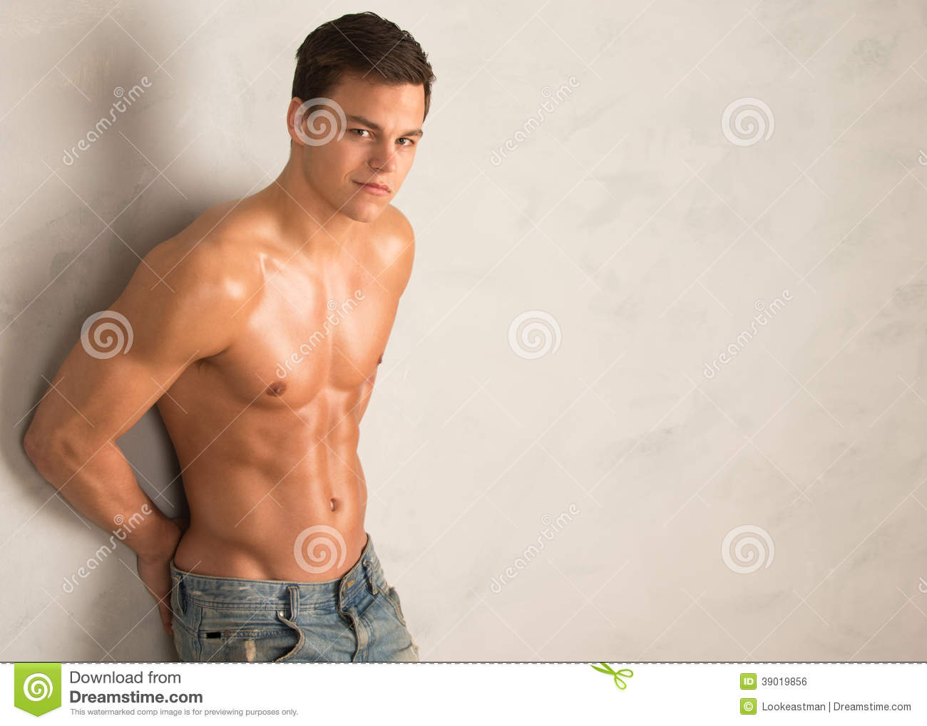 young shredded man against a wall stock image image of looking