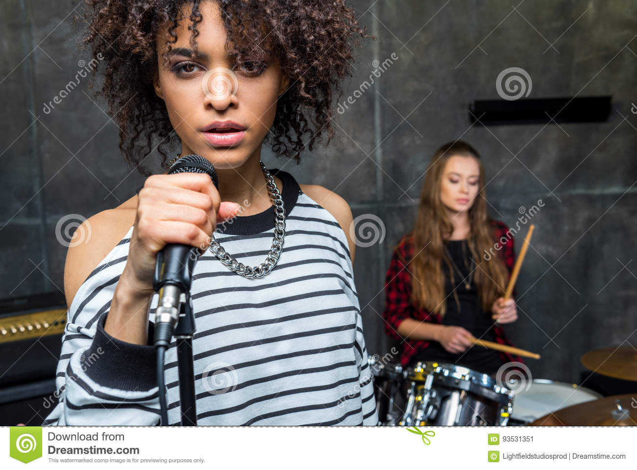 Fulllength Portrait Of Rock Singer With Mic Stock Photo