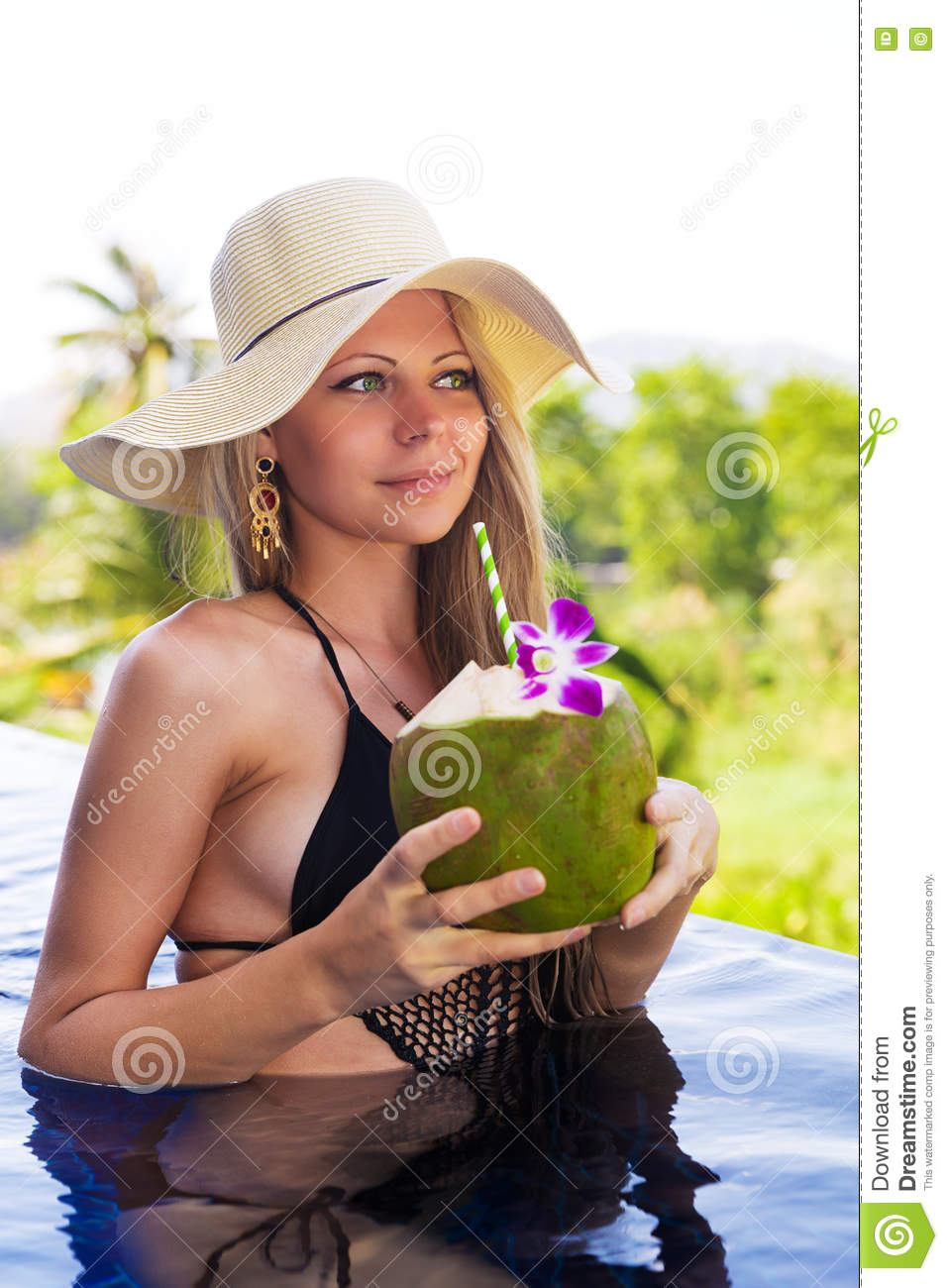 Girl In Straw Hat Drinks Water Royalty Free Stock