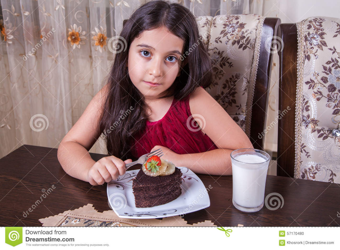 Young Small Beautiful Middle Eastern Child Girl With Chocolate Cake