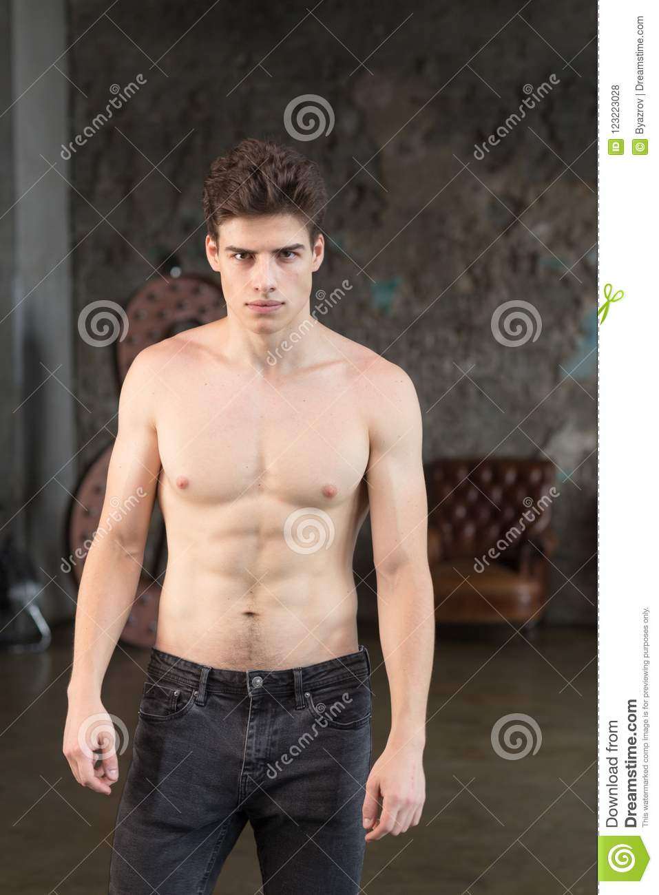 Young Smart Male Fashion Model With Dark Brown Hair Stock