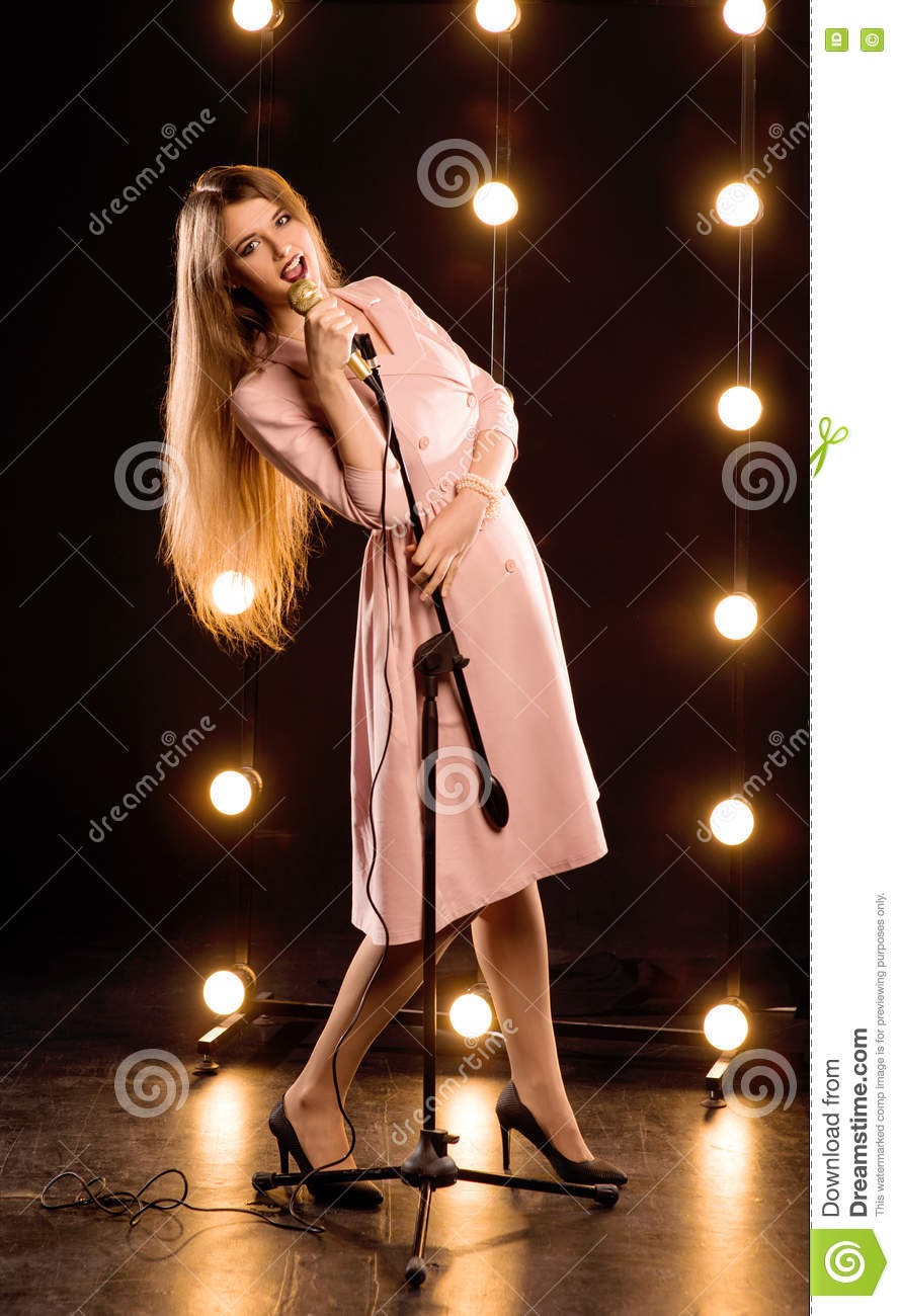 Young Smiley Beautiful Long Hair Girl With Microphone Stock