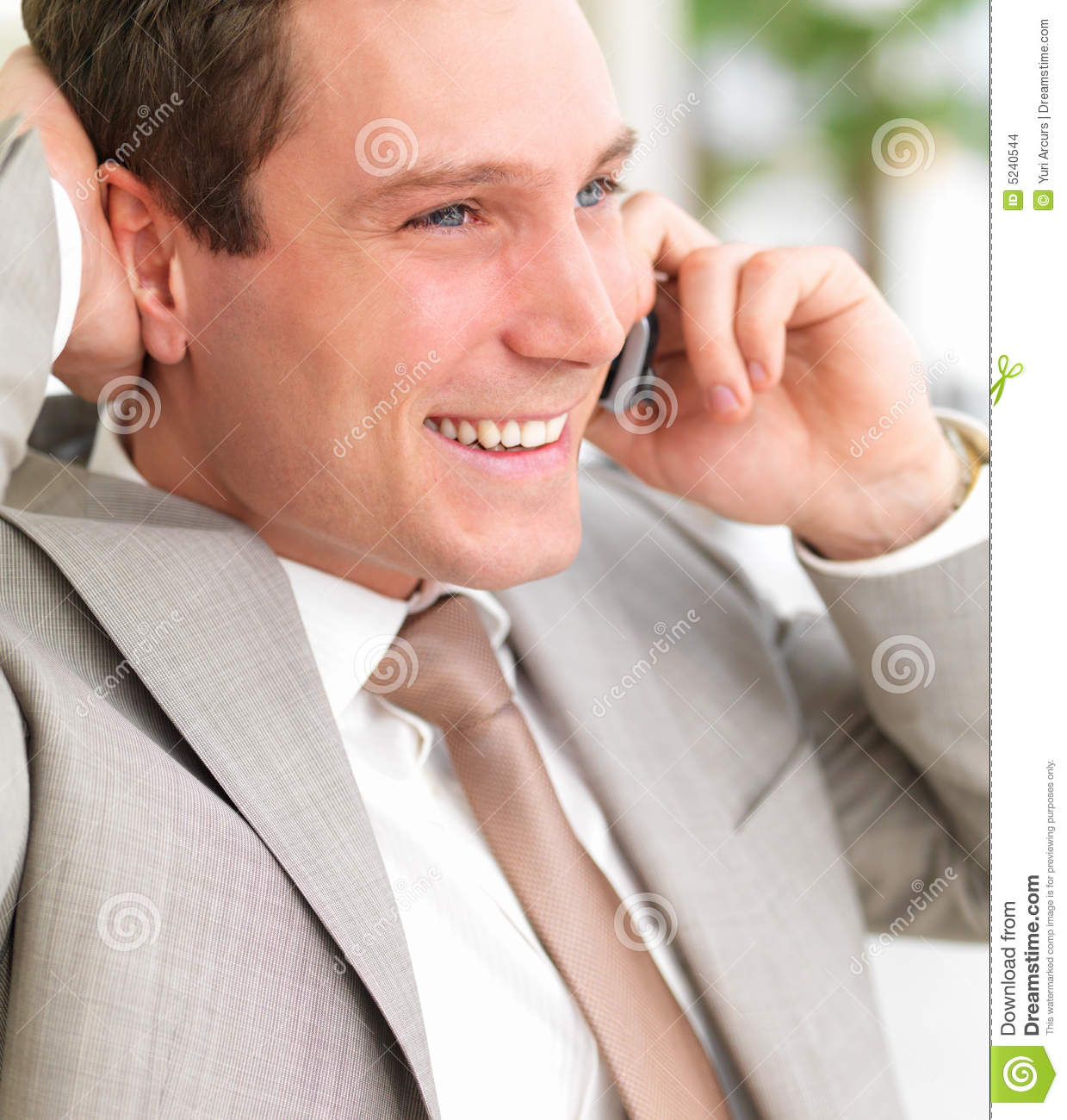 Man On Cell Phone : Young smiling business man using cell phone with h stock
