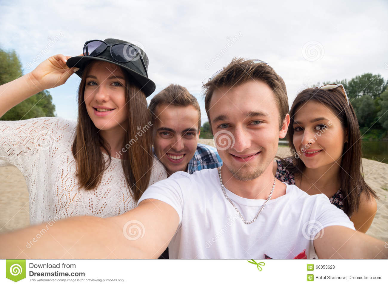 Young Smiling Friends Taking Selfie On Sandy Beach Stock ...