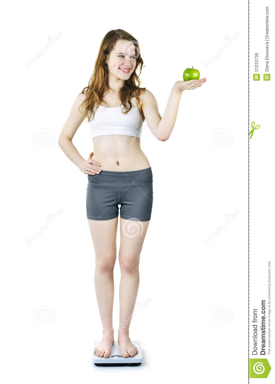 Young Smiling Girl On Bathroom Scale Holding Apple Royalty