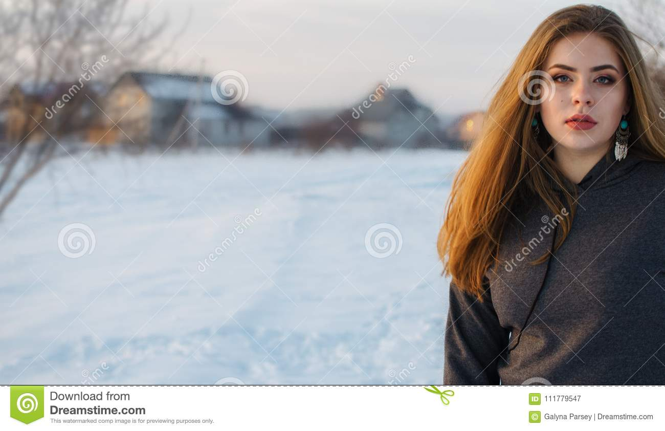 Young smiling girl in the winter