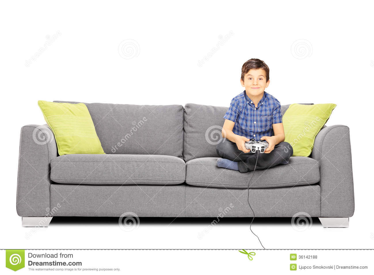 Young Smiling Kid Seated A Sofa Playing Video Games Royalty