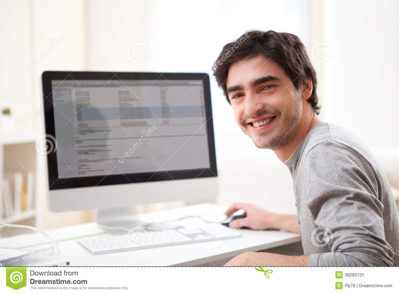 young smiling man in front of computer stock image image of