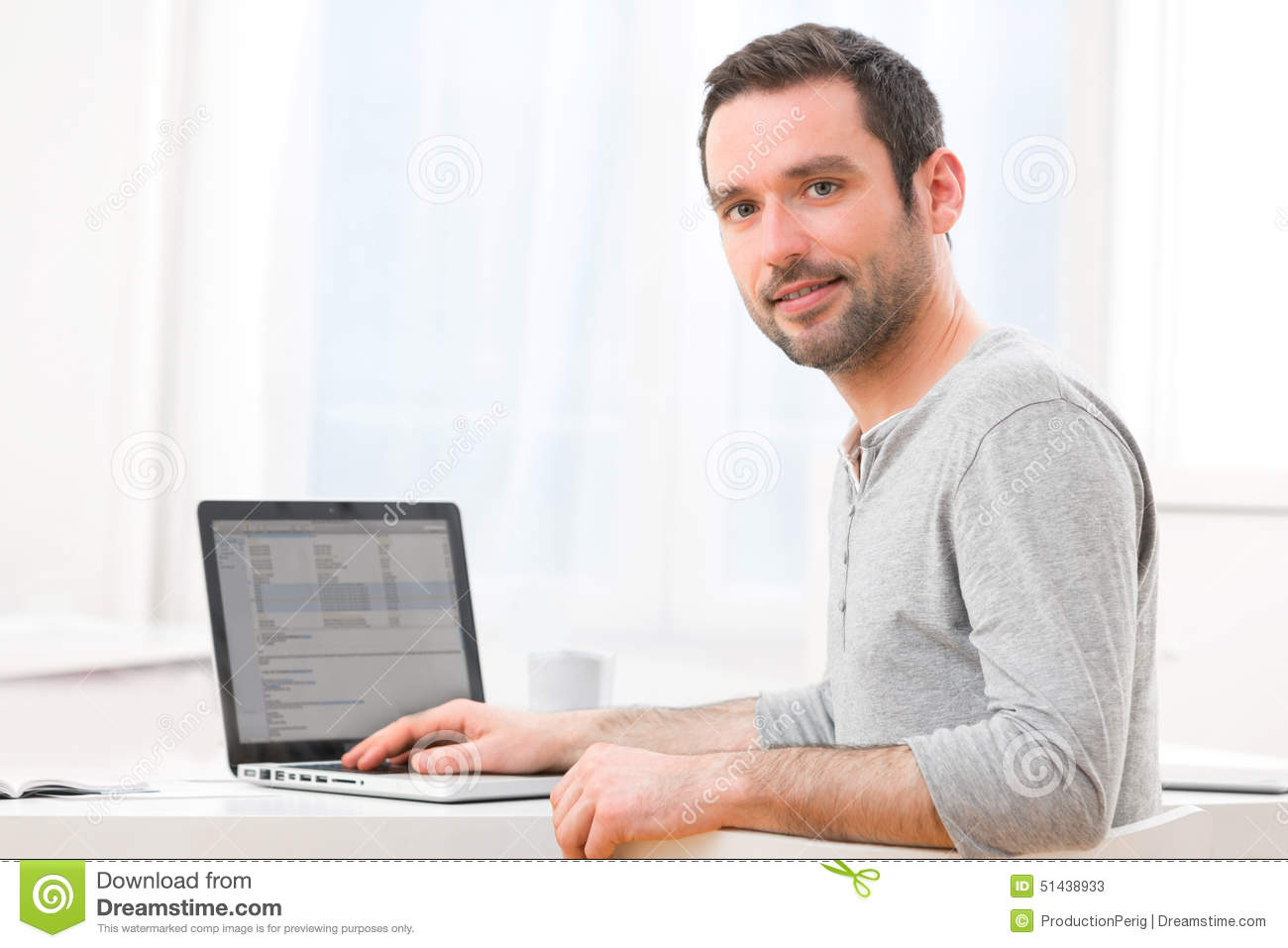 young smiling man in front of a computer stock image image of