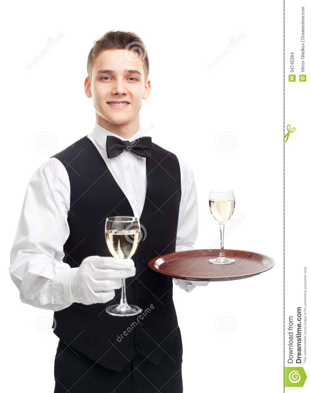 Portrait of young happy smiling waiter holding glasses of white wine ...