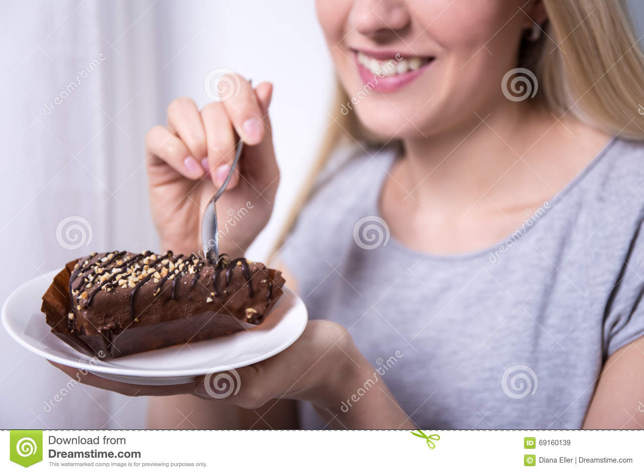 Young Smiling Woman Eating Chocolate Cake At Home Stock Image