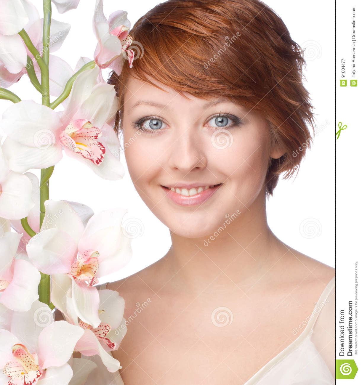 Young smiling woman with orchid