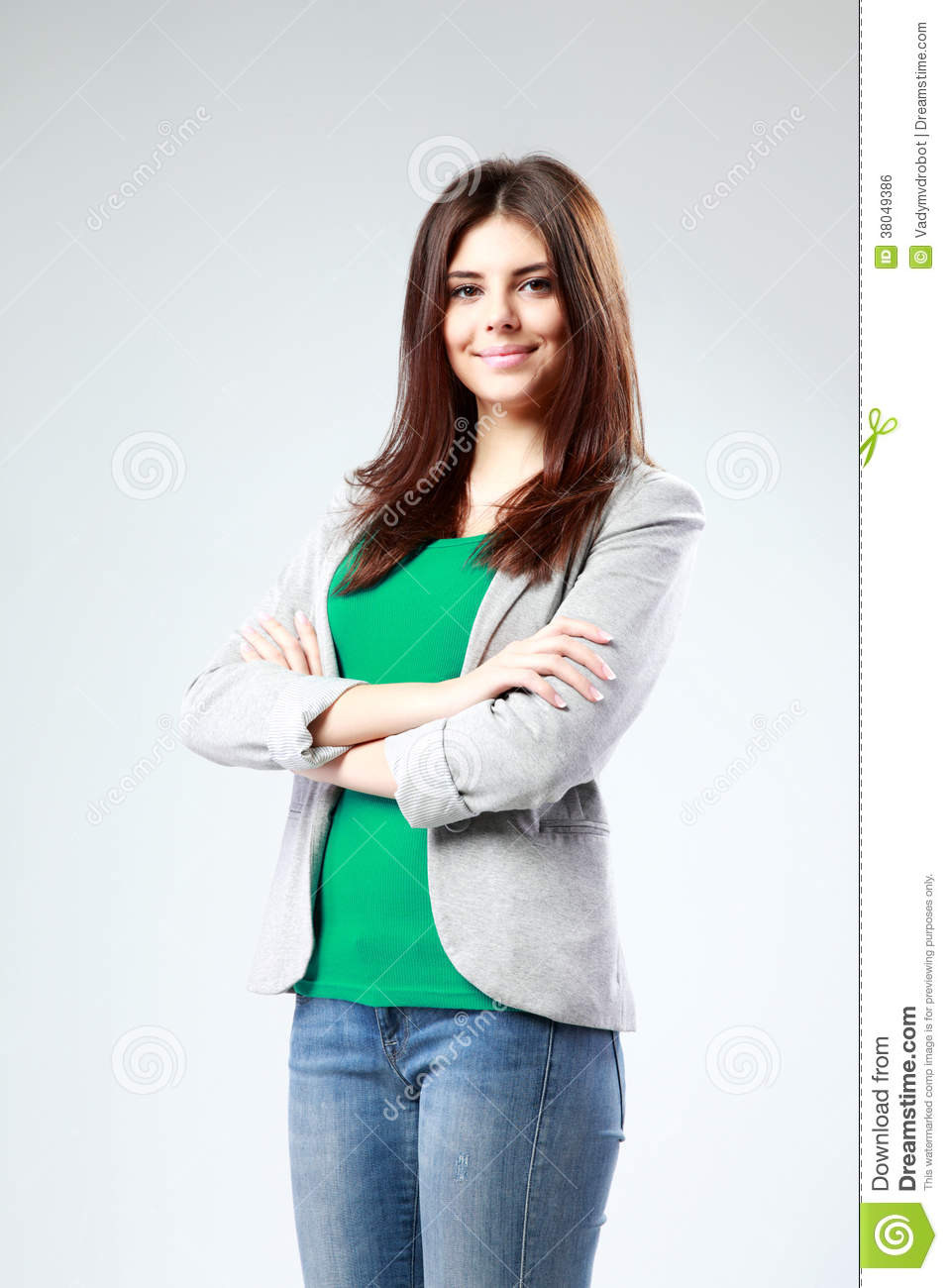 Smiling Woman Standing With Arms Folded Royalty-Free Stock ...