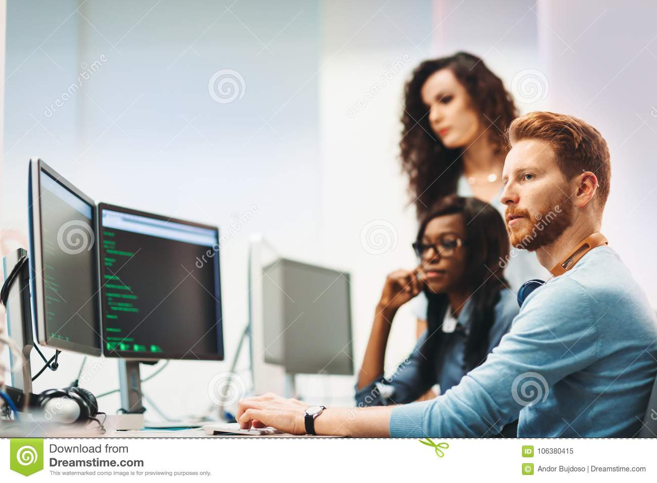 Software engineers working on project and programming in company