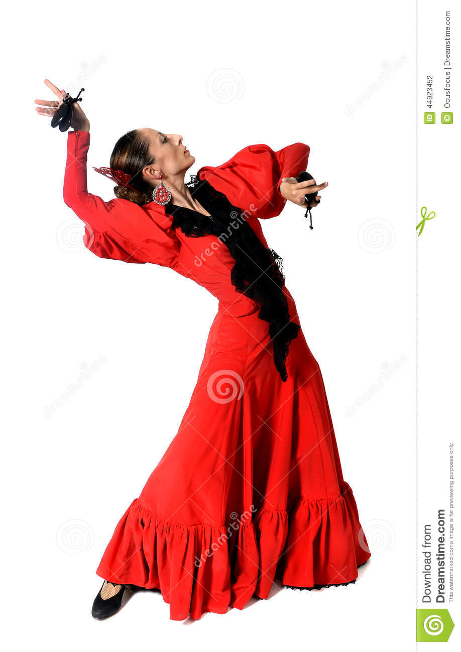Young Spanish Woman Dancing Flamenco With Castanets In Her ...