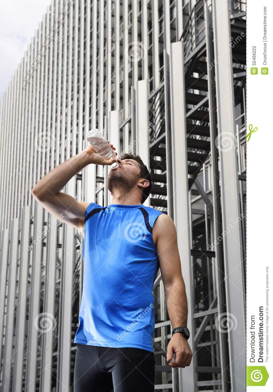 Young Sport Man Drinking Water Bottle After Running ...