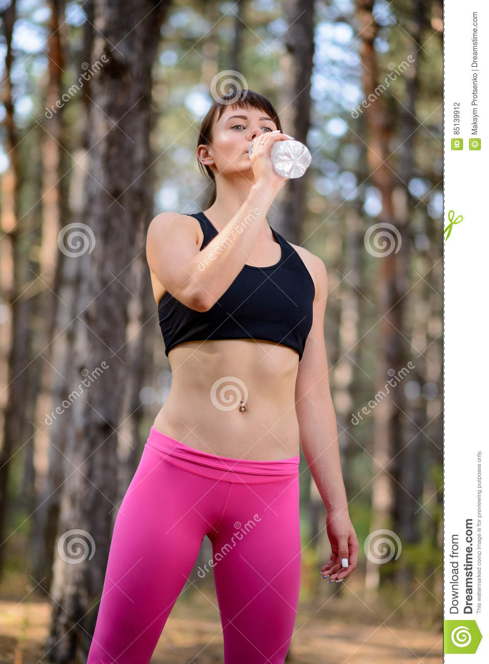 Beautiful Athletic Woman Is Drinking Pure Water From The ...