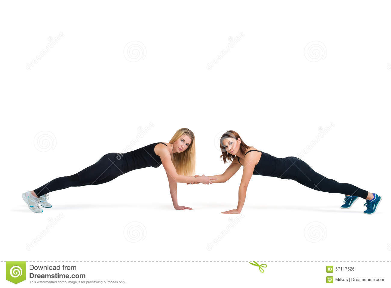 Young Sportive Women Make Fitness Push Ups Together Stock Photo