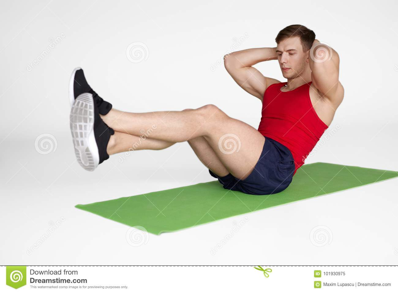 Concentrated Man Training Abdominal Muscles Stock Image