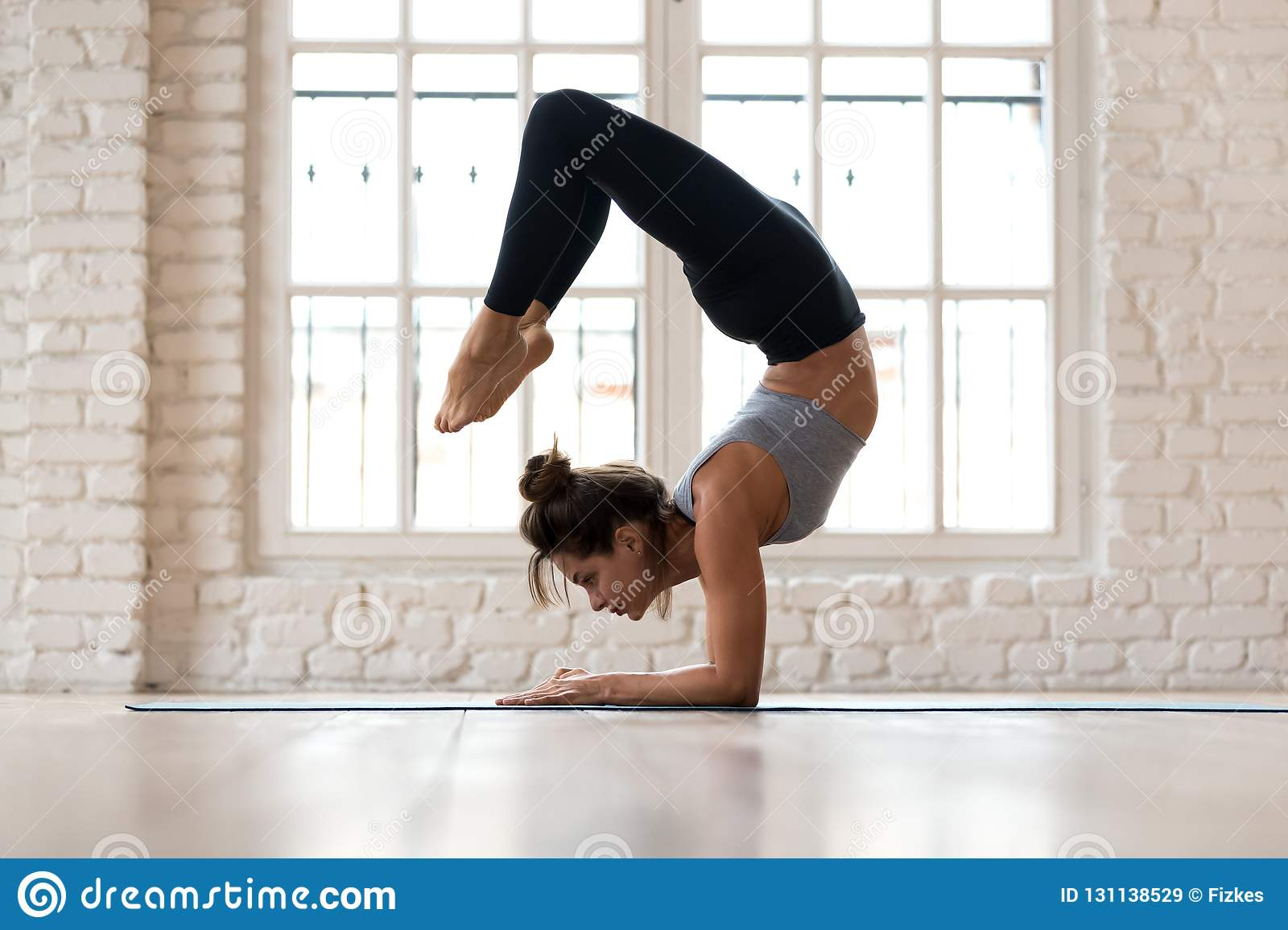 acd0809242392 Young Sporty Attractive Woman Practicing Yoga Scorpion Pose Stock ...