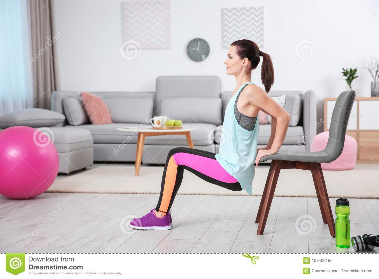 Young sporty woman doing exercise
