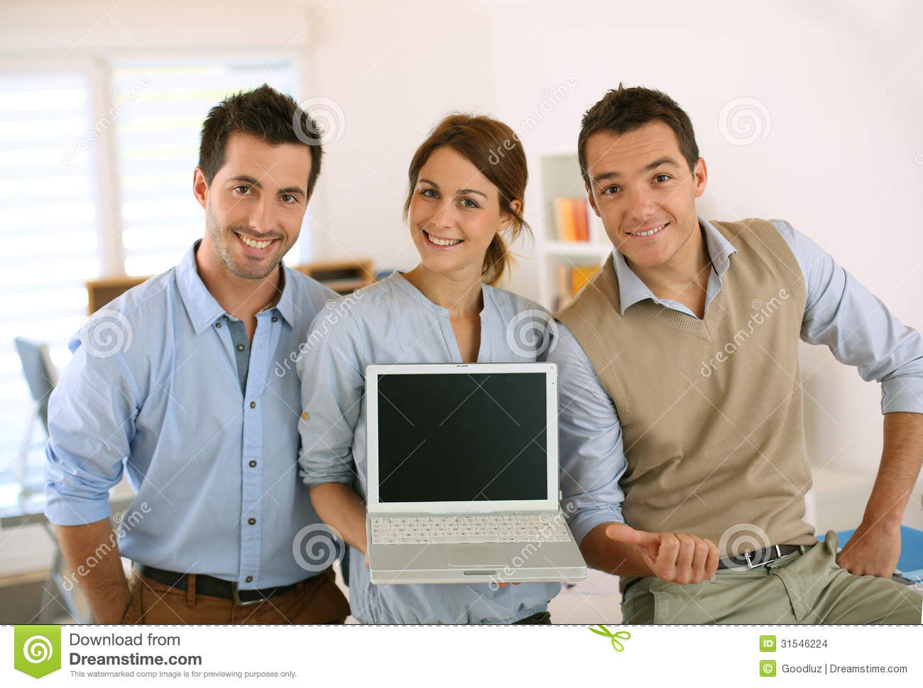 Young startup showing text or results on laptop screen